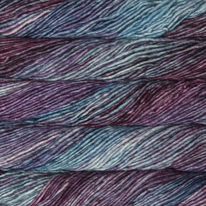 Skein of Malabrigo Mecha Bulky weight yarn in the color Lotus (Purple) for knitting and crocheting.