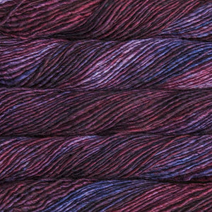 Skein of Malabrigo Mecha Bulky weight yarn in the color Paysandu (Purple) for knitting and crocheting.