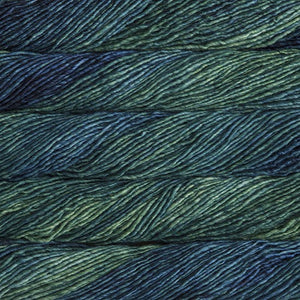 Skein of Malabrigo Mecha Bulky weight yarn in the color Solis (Blue) for knitting and crocheting.