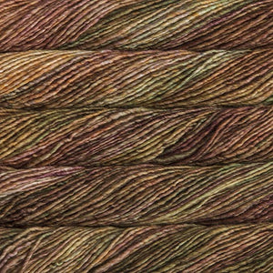 Skein of Malabrigo Mecha Bulky weight yarn in the color Tabacos (Brown) for knitting and crocheting.