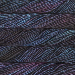 Skein of Malabrigo Mecha Bulky weight yarn in the color Whales Road (Purple) for knitting and crocheting.