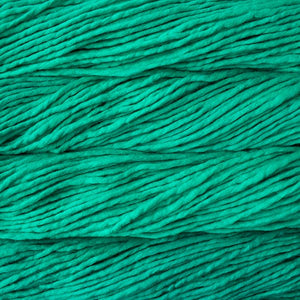 Skein of Malabrigo Rasta Super Bulky weight yarn in the color Bahamas Green (Green) for knitting and crocheting.