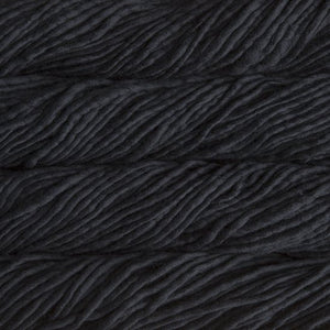 Skein of Malabrigo Rasta Super Bulky weight yarn in the color Black (Black) for knitting and crocheting.