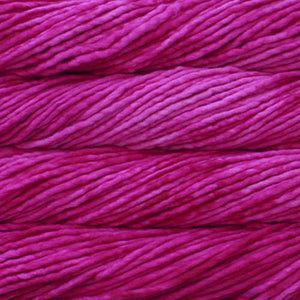 Skein of Malabrigo Rasta Super Bulky weight yarn in the color Fucsia (Pink) for knitting and crocheting.