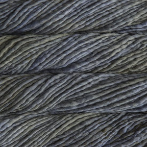 Skein of Malabrigo Rasta Super Bulky weight yarn in the color Garden Gate (Gray) for knitting and crocheting.