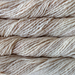 Skein of Malabrigo Rasta Super Bulky weight yarn in the color Ivory (Cream) for knitting and crocheting.