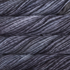 Skein of Malabrigo Rasta Super Bulky weight yarn in the color Plomo (Gray) for knitting and crocheting.
