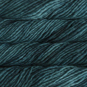 Skein of Malabrigo Rasta Super Bulky weight yarn in the color Teal Feather (Green) for knitting and crocheting.