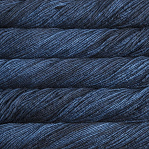 Skein of Malabrigo Rios Worsted weight yarn in the color Azul Profundo (Blue) for knitting and crocheting.