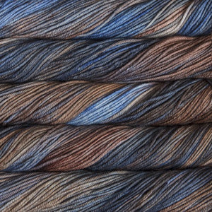 Skein of Malabrigo Rios Worsted weight yarn in the color Cielo y Tierra (Blue) for knitting and crocheting.