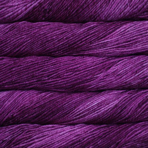 Skein of Malabrigo Rios Worsted weight yarn in the color Hollyhock (Purple) for knitting and crocheting.