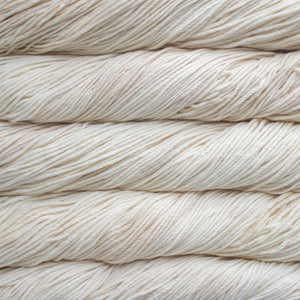 Skein of Malabrigo Rios Worsted weight yarn in the color Ivory (Cream) for knitting and crocheting.