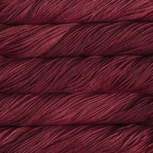 Load image into Gallery viewer, Skein of Malabrigo Rios Worsted weight yarn in the color Ravelry Red (Pink) for knitting and crocheting.