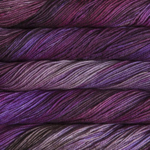 Skein of Malabrigo Rios Worsted weight yarn in the color Sabiduria (Purple) for knitting and crocheting.