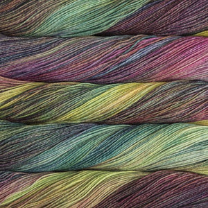 Skein of Malabrigo Sock Sock weight yarn in the color Arco Iris (multi) for knitting and crocheting.