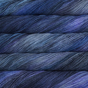 Skein of Malabrigo Sock Sock weight yarn in the color Azules (Blue) for knitting and crocheting.