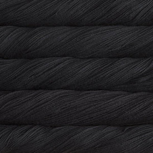 Skein of Malabrigo Sock Sock weight yarn in the color Black (Black) for knitting and crocheting.