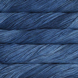 Skein of Malabrigo Sock Sock weight yarn in the color Impressionist Sky (Blue) for knitting and crocheting.