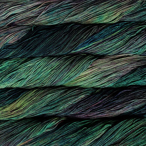 Skein of Malabrigo Sock Sock weight yarn in the color Indonesia (Green) for knitting and crocheting.