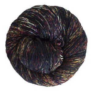 Skein of Malabrigo Sock Sock weight yarn in the color Mask (Black) for knitting and crocheting.
