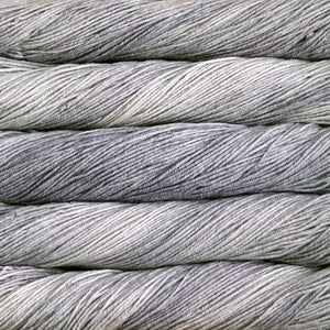 Skein of Malabrigo Sock Sock weight yarn in the color Pearl (Gray) for knitting and crocheting.