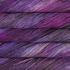 Skein of Malabrigo Sock Sock weight yarn in the color Sabiduria (Purple) for knitting and crocheting.
