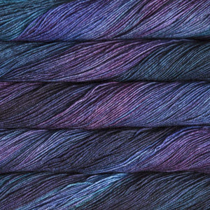Skein of Malabrigo Sock Sock weight yarn in the color Whales Road (Purple) for knitting and crocheting.