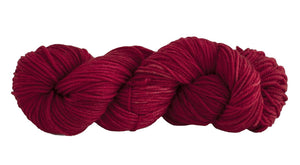 Skein of Manos del Uruguay Alegria Grande Worsted weight yarn in the color Carmine (Red) for knitting and crocheting.