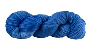 Skein of Manos del Uruguay Alegria Grande Worsted weight yarn in the color Lapis Lazuli (Blue) for knitting and crocheting.