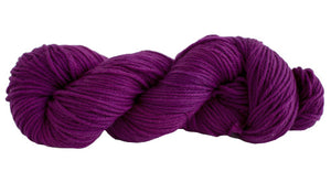 Skein of Manos del Uruguay Alegria Grande Worsted weight yarn in the color Magenta (Purple) for knitting and crocheting.