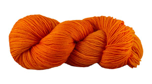 Skein of Manos del Uruguay Alegria Sock weight yarn in the color Building Block (Orange) for knitting and crocheting.