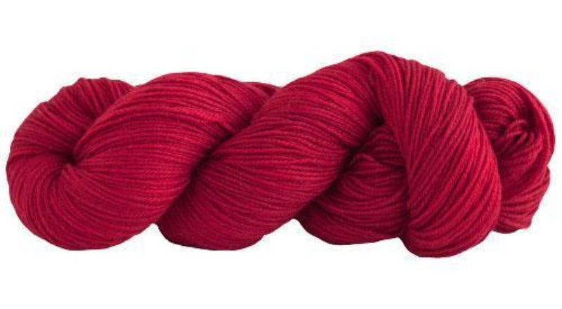 Skein of Manos del Uruguay Alegria Sock weight yarn in the color Carmine (Red) for knitting and crocheting.