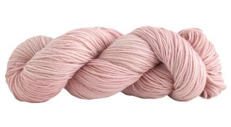 Skein of Manos del Uruguay Alegria Sock weight yarn in the color Petal (Pink) for knitting and crocheting.