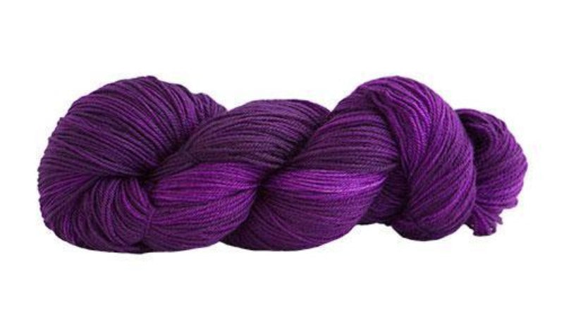 Skein of Manos del Uruguay Alegria Sock weight yarn in the color Tafetta (Purple) for knitting and crocheting.