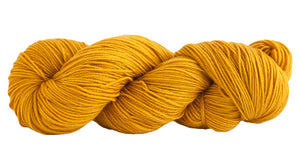 Skein of Manos del Uruguay Alegria Sock weight yarn in the color Turmeric (Yellow) for knitting and crocheting.