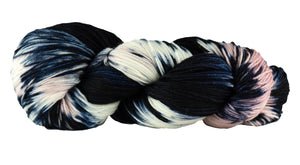 Skein of Manos del Uruguay Alegria Space-Dyed Sock weight yarn in the color Cabaret (Black) for knitting and crocheting.