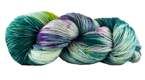 Skein of Manos del Uruguay Alegria Space-Dyed Sock weight yarn in the color Orquidea (Green) for knitting and crocheting.