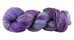 Skein of Manos del Uruguay Alegria Space-Dyed Sock weight yarn in the color Sari (Purple) for knitting and crocheting.
