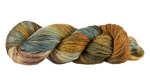 Skein of Manos del Uruguay Feliz Space-Dyed Sport weight yarn in the color Grizzly (Brown) for knitting and crocheting.