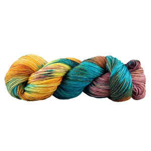 Skein of Manos del Uruguay Feliz Space-Dyed Sport weight yarn in the color Huarache (Multi) for knitting and crocheting.