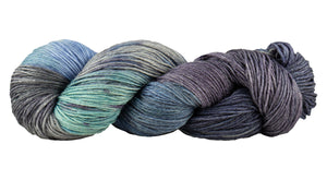 Skein of Manos del Uruguay Feliz Space-Dyed Sport weight yarn in the color Provence (Gray) for knitting and crocheting.