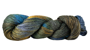 Skein of Manos del Uruguay Feliz Space-Dyed Sport weight yarn in the color Stellar (Blue) for knitting and crocheting.
