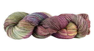 Skein of Manos del Uruguay Feliz Space-Dyed Sport weight yarn in the color Wildflowers (Purple) for knitting and crocheting.