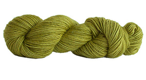 Skein of Manos del Uruguay Silk Blend DK weight yarn in the color Citric (Green) for knitting and crocheting.