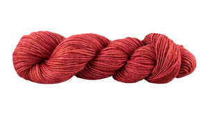 Skein of Manos del Uruguay Silk Blend DK weight yarn in the color Clafoutis (Red) for knitting and crocheting.