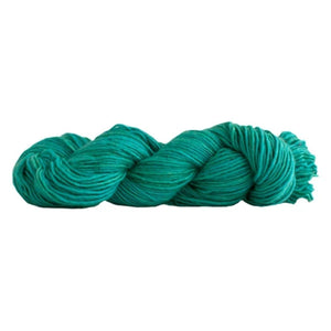 Skein of Manos del Uruguay Silk Blend DK weight yarn in the color Tahiti (Green) for knitting and crocheting.