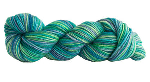 Skein of Manos del Uruguay Silk Blend Space-Dyed DK weight yarn in the color Caribe (Green) for knitting and crocheting.