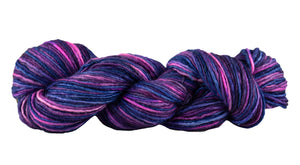 Skein of Manos del Uruguay Silk Blend Space-Dyed DK weight yarn in the color Fractal (Purple) for knitting and crocheting.
