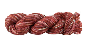 Skein of Manos del Uruguay Silk Blend Space-Dyed DK weight yarn in the color Killim (Red) for knitting and crocheting.