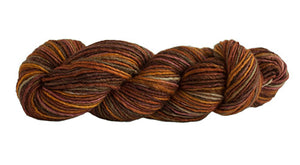 Skein of Manos del Uruguay Silk Blend Space-Dyed DK weight yarn in the color Prairie (Brown) for knitting and crocheting.